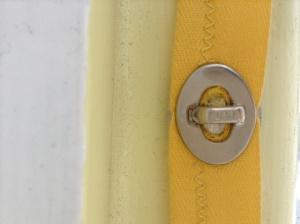 Turn buckle/button fastenings